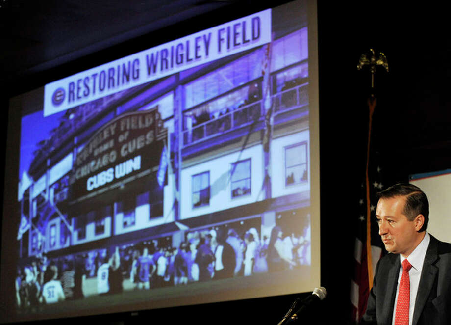 FILE - In this May 1, 2013 file photo, Chicago Cubs Chairman Tom Ricketts speaks in Chicago about proposed renovations at Wrigley Field. A battle is heating up between the Cubs and rooftop owners across the street from the ballpark as the team proposes renovations, including a Jumbotron in the bleachers, that would block the views and threaten the business those views have created. (AP Photo/Paul Beaty, File) / FR36811 AP