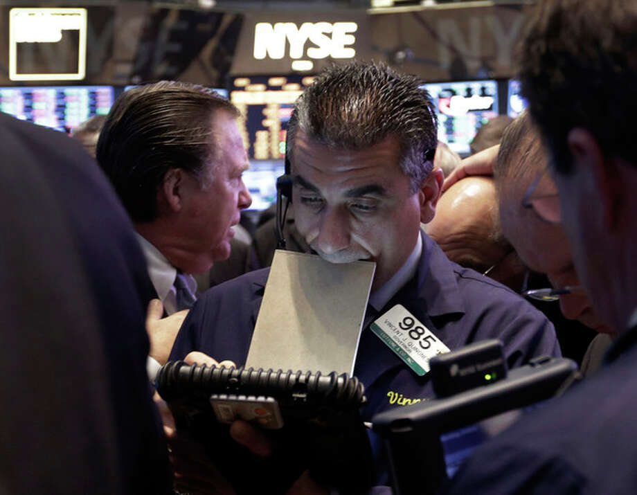 In this Thursday, May 23, 2013, photo, Trader Vincent Quinones, center, works on the floor of the New York Stock Exchange at the close of trading. Steady growth in hiring in May 2013 is sending the stock market sharply higher, Friday, June 7, 2013. (AP Photo/Richard Drew) / AP