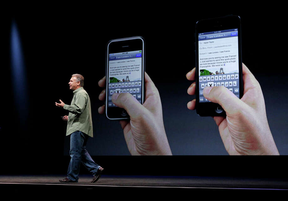 Phil Schiller, Apple's senior vice president of worldwide marketing, speaks on stage during an introduction of the new iPhone 5 at an Apple event in San Francisco, Wednesday Sept. 12, 2012. (AP Photo/Eric Risberg) / AP