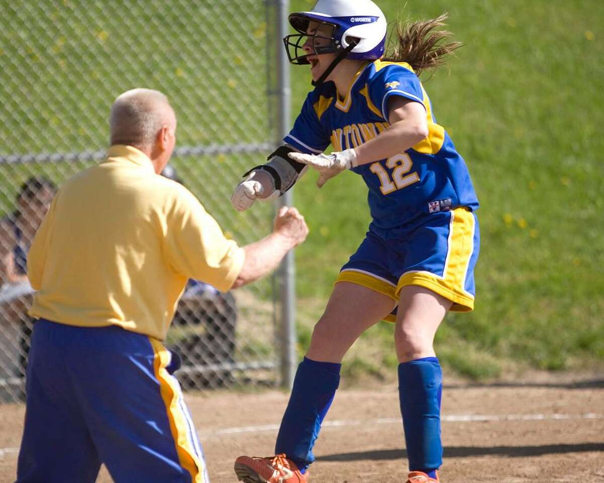 Newtown's Kate Bowen celebrates her home run against Brookfield with assistant coach Lin Hertzberg Friday at Brookfield High.
