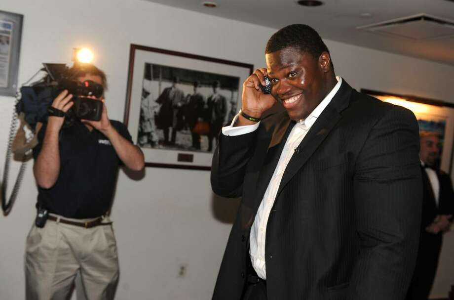 Vlad Ducasse takes the call from the NFL informing him that he has been drafted to the New York Jets, during the NFL draft pick gathering at Morton's Steakhouse in downtown Stamford, Conn. on Friday April 23, 2010. Photo: Christian Abraham / Connecticut Post