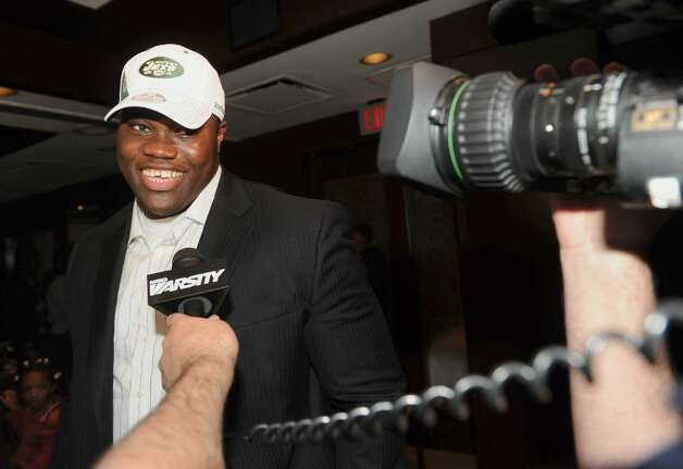 Vlad Ducasse takes questions from the media after learning he will be joining the New York Jets, during the NFL draft pick gathering at Morton's Steakhouse in downtown Stamford, Conn. on Friday April 23, 2010. Photo: Christian Abraham / Connecticut Post