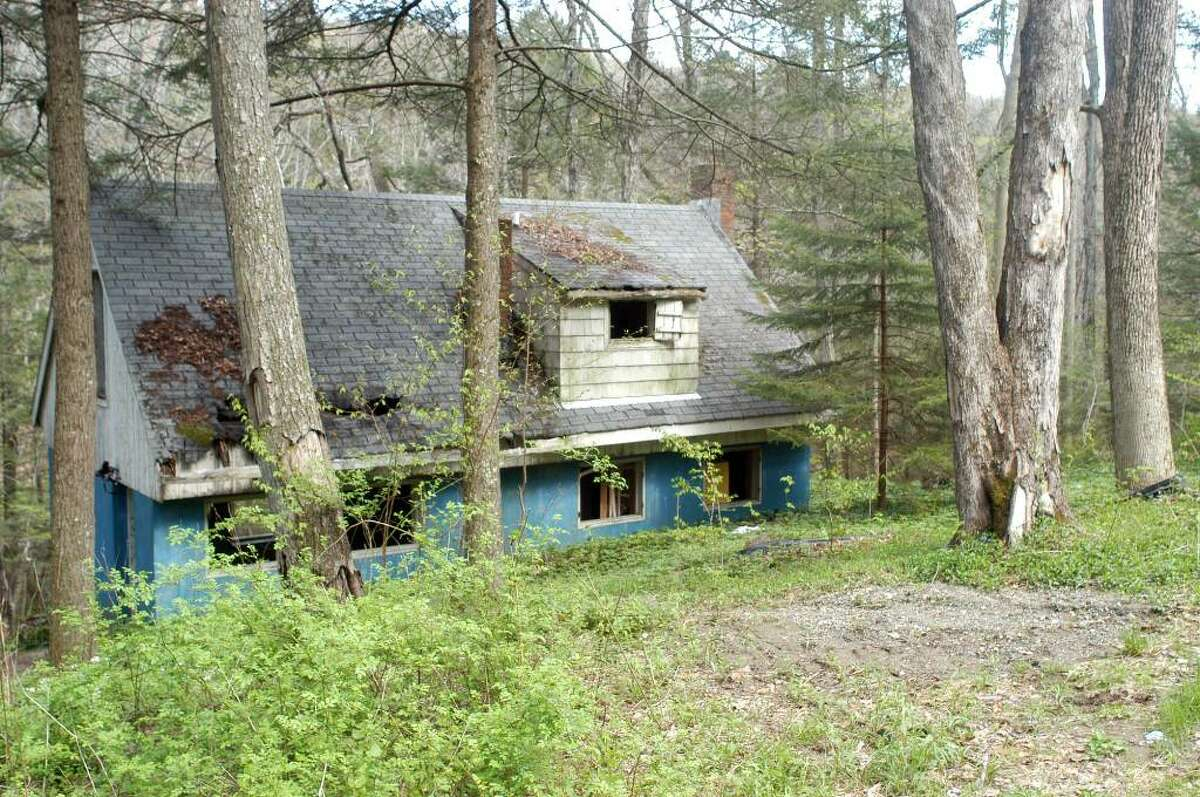 The abandoned Bridgeport house, located not far from the Pomperaug River in Southbury, where Michael Weaving and the two friends suspected of killing him spent time before Weaving was killed last month