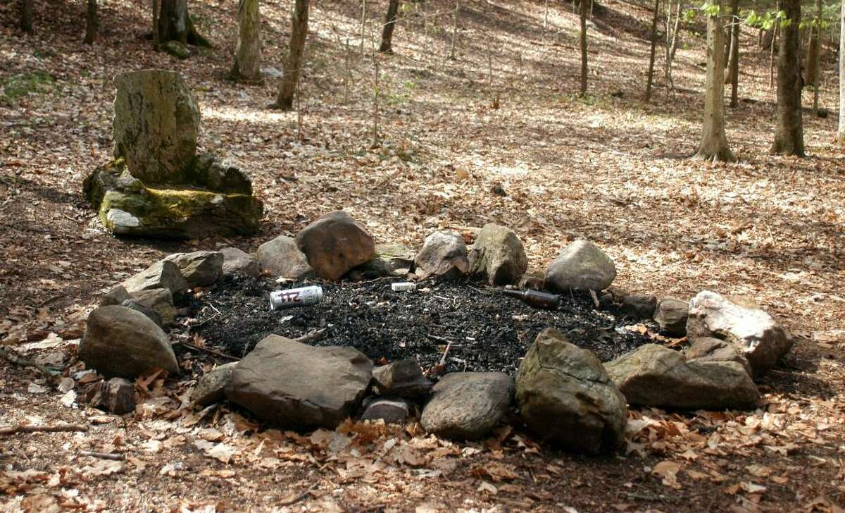 Fire pit along the Pomperaug River, a popular hangout for young people to drink and party in Southbury is where Michael Weaving spent hios last hours with the two friend suspected of killing him last month.