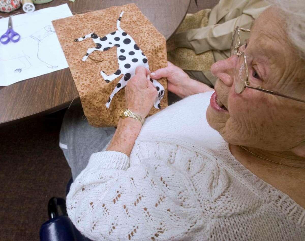 Antonia Bonaccina of Bethel, working on her 26th Senior Center fundraising quilt, sews a Dalmatian patch at the Senior Center. Thursday, April 22, 2010