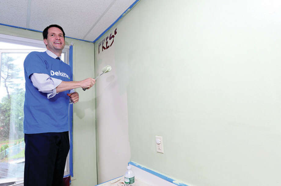 Congressman Jim Himes joins Deloitte's Stamford office at the Carver Center as they volunteer their time for the Center's most critical need of facilities improvements. Part of Deloitte's IMPACT Day - a national celebration of Deloitte's year-round Impact Imperative - the culture of volunteerism that fuels the organization's commitment to contribute its professionals' time and talents to leading nonprofits. This year marks Deloitte's 14th annual IMPACT Day. On June 7, all 50,000+ Deloitte personnel are encouraged to put their work on hold and volunteer at more than 800 projects in 80 communities.Hour photo / Erik Trautmann / (C)2013, The Hour Newspapers, all rights reserved