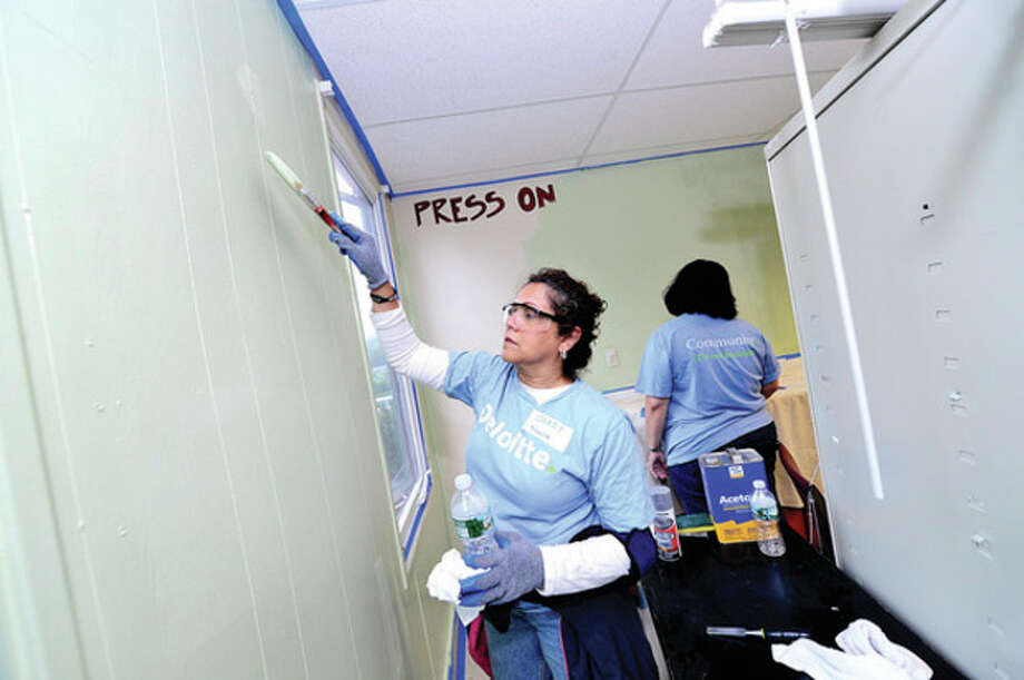 Sandy D'Souza of Deloitte's Stamford office volunteers at the Carver Center to aid in the Center's most critical need of facilities improvements. Part of Deloitte's IMPACT Day - a national celebration of Deloitte's year-round Impact Imperative - the culture of volunteerism that fuels the organization's commitment to contribute its professionals' time and talents to leading nonprofits. This year marks Deloitte's 14th annual IMPACT Day. On June 7, all 50,000+ Deloitte personnel are encouraged to put their work on hold and volunteer at more than 800 projects in 80 communities.Hour photo / Erik Trautmann / (C)2013, The Hour Newspapers, all rights reserved