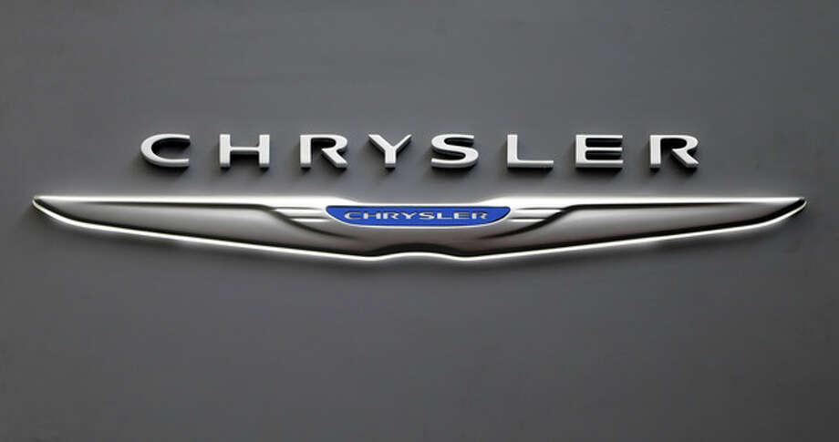 This Feb. 14, 2013 photo shows the Chrysler logo on a sign at the 2013 Pittsburgh Auto Show in Pittsburgh. Chrysler's U.S. sales rose 11 percent in May, a sign that auto sales rebounded from a slight dip in April and will continue to boost the U.S. economy. (AP Photo/Gene J. Puskar) / AP
