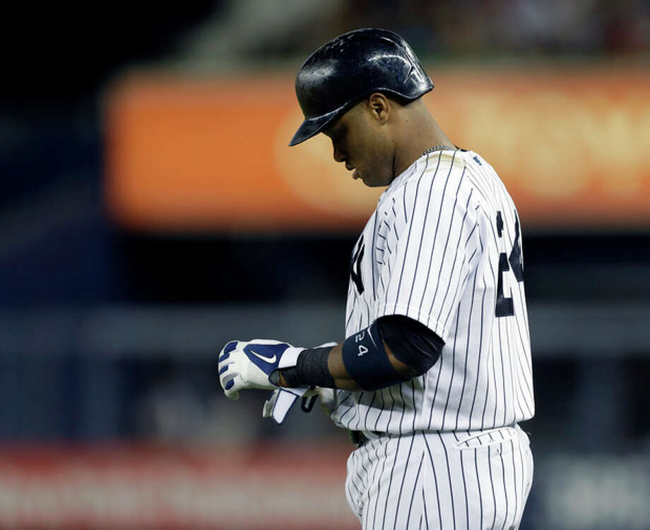 New York Yankees' Robinson Cano (24) reacts after hitting into a third-inning double play in a baseball game against the New York Yankees at Yankee Stadium in New York, Sunday, June 2, 2013. (AP Photo/Kathy Willens) / AP