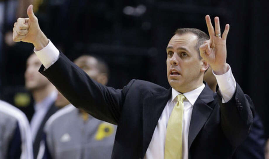 Indiana Pacers head coach Frank Vogel directs his team during the first half of Game 6 of the NBA Eastern Conference basketball finals against the Miami Heat in Indianapolis, Saturday, June 1, 2013. (AP Photo/Michael Conroy) / AP