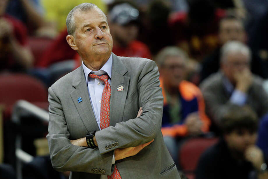 FILE - In this March 15, 2012, file photo, Connecticut head coach Jim Calhoun watches from the sidline in the first half of their second-round NCAA tournament college basketball game against Iowa State in Louisville, Ky. Calhoun is expected to announce his retirement on Thursday, Sept. 13, according to a person familiar with the situation. (AP Photo/John Bazemore, File) / AP