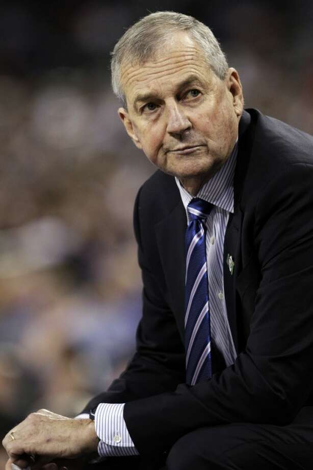 FILE - In this April 4, 2011, file photo, Connecticut head coach Jim Calhoun sits on the sideline during the second half of the men's NCAA Final Four college basketball championship game against Butler in Houston. Calhoun is expected to announce his retirement on Thursday, Sept. 13, 2012, according to a person familiar with the situation. (AP Photo/Eric Gay, File)