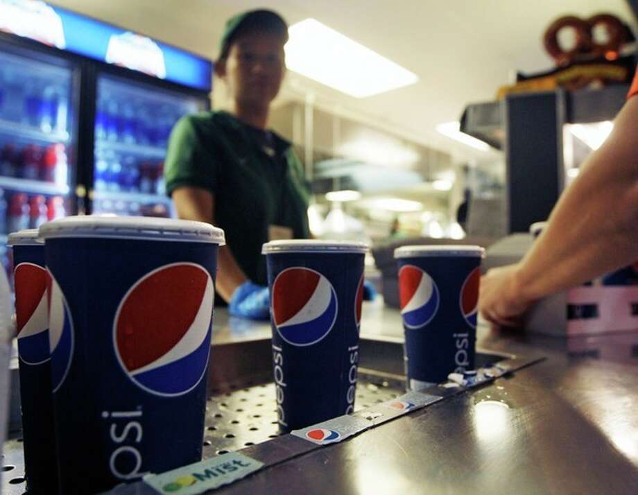 Soft drinks are on display during a baseball game between the New York Mets and the Washington Nationals Wednesday, Sept. 12, 2012, in New York. Health officials are expected to approve an unprecedented 16-ounce limit on sodas and other sugary drinks sold at restaurants, delis and movie theaters. (AP Photo/Frank Franklin II) / AP