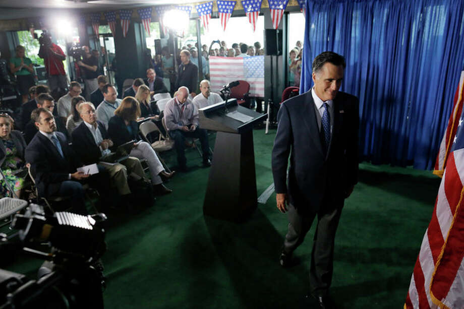 Republican presidential candidate, former Massachusetts Gov. Mitt Romney leaves the podium after making comments on the killing of U.S. embassy officials in Benghazi, Libya, Wednesday, Sept. 12, 2012. in Jacksonville, Fla. (AP Photo/Charles Dharapak) / AP