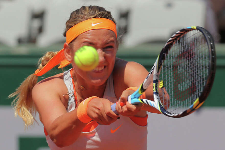 Victoria Azarenka of Belarus returns against Russia's Maria Kirilenko in their quarterfinal match at the French Open tennis tournament, at Roland Garros stadium in Paris, Wednesday June 5, 2013. (AP Photo/Michel Euler) / AP