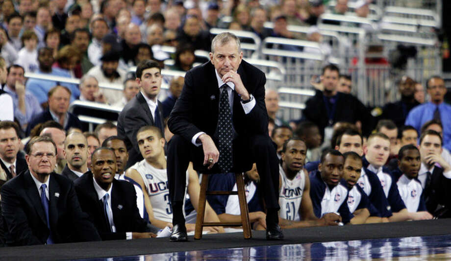 FILE - In this April 4, 2009, file photo, Connecticut head coach Jim Calhoun, center, watches from the sideline during a men's NCAA Final Four semifinal college basketball game against Michigan State in Detroit. Calhoun is expected to announce his retirement on Thursday, Sept. 13, 2012, according to a person familiar with the situation. (AP Photo/Paul Sancya, File) / AP