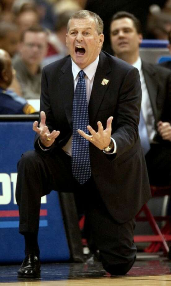 FILE - In this April 5, 2004, file photo, Connecticut head coach Jim Calhoun shouts out to his team in the second half of the NCAA Final Four college championship game against Georgia Tech in San Antonio. Calhoun is expected to announce his retirement on Thursday, Sept. 13, 2012, according to a personal familiar with the situation. (AP Photo/Ed Reinke, File)