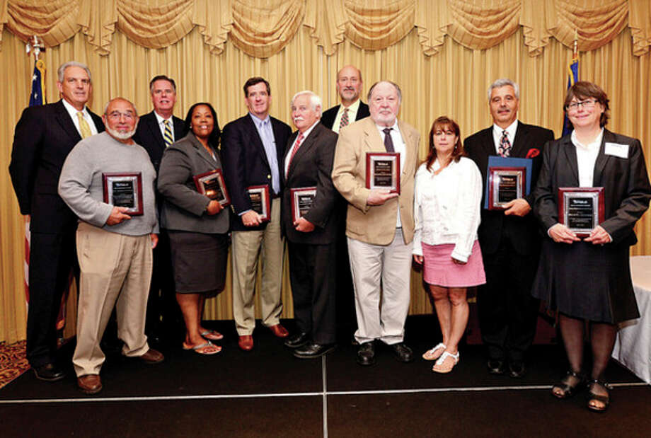 Mike Sutton and Ed Musante of the Great Norwalk Chamber of Commerce, second row left, joins the Greater Norwalk Chamber of Commerce Small Business Awards recipients Hank May, Novelette Peterkin, Chris McMahon, Bill Skidd, Harrison Gill, Hu Lindsay, Deb Randall, Rich Tavella accepting for Partners Cafe and Patsy Gill during the annual banquet at the Norwalk Inn Wednesday.Hour photo / Erik Trautmann / (C)2013, The Hour Newspapers, all rights reserved