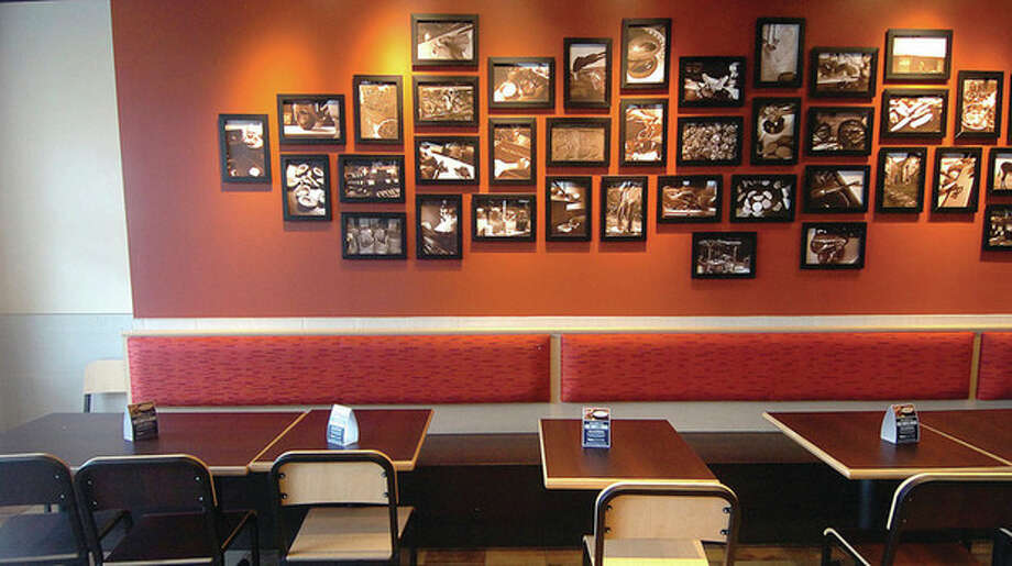 Hour Photo/Alex von Kleydorff. Framed photos taken by Qdoba Restaurants Master Chef during one of his trips to Mexico hang in the Norwalk Qdoba Mexican Grill. / 2013 The Hour Newspapers