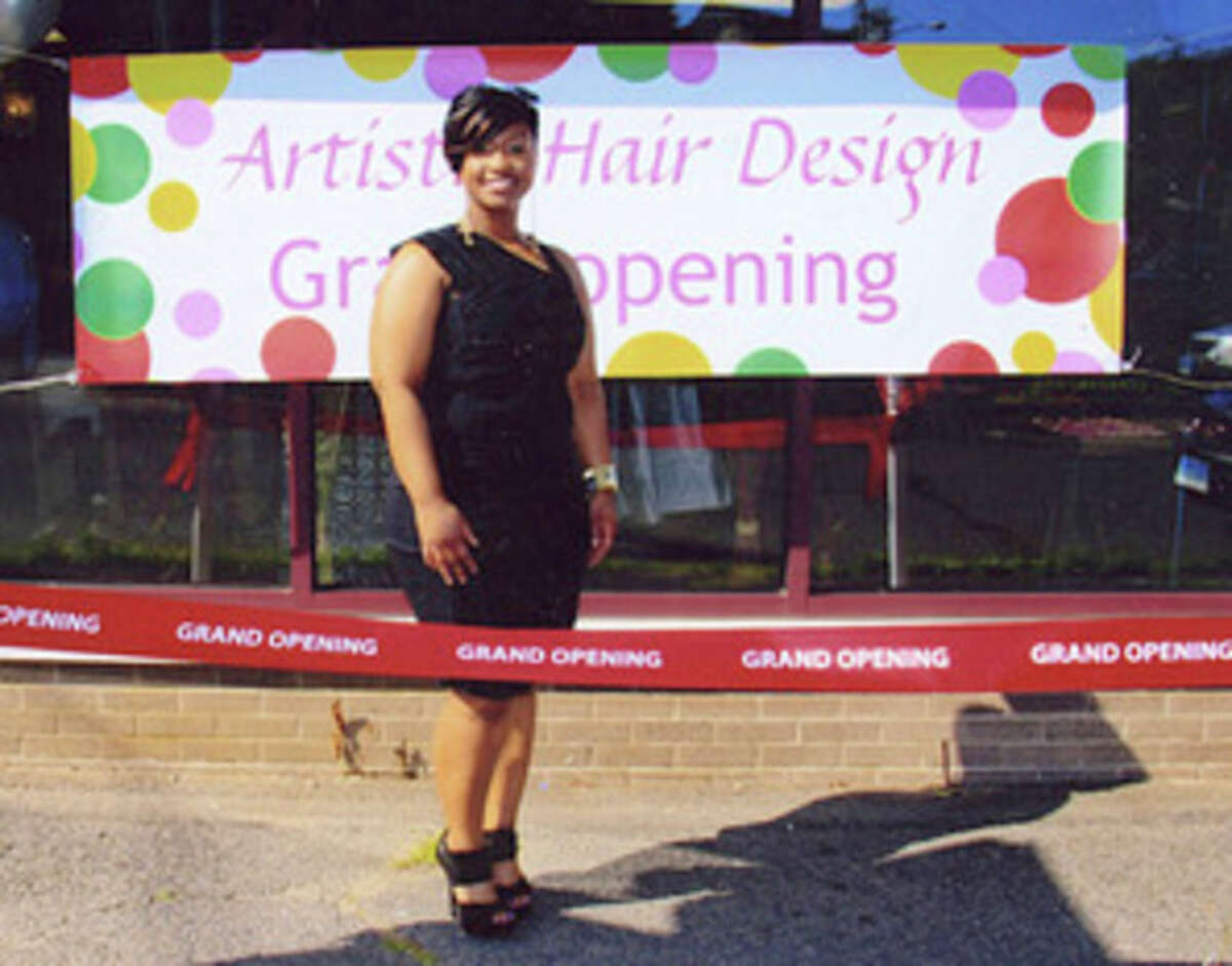 Natasha Ramsubhag stands in front of her hair salon business during the grand opening event this summer. Contributed photo
