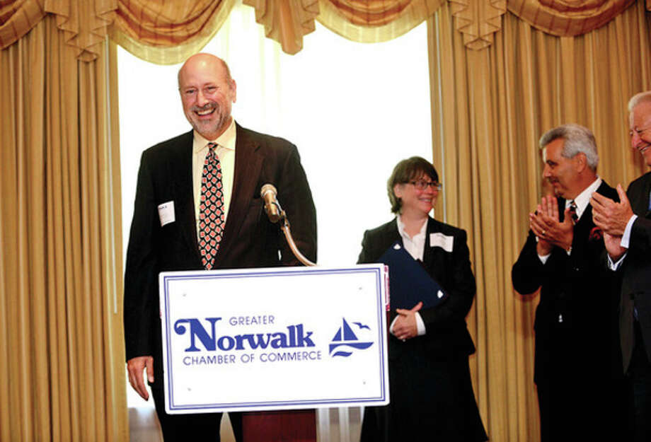 Hour photo / Erik TrautmannAbove, Harrison Gill of Gill & Gill Architects accepts one of the Greater Norwalk Chamber of Commerce Small Business Awards during the annual banquet at the Norwalk Inn Wednesday. At right, Hank May of Hank May Goodyear Tire & Auto Service is congratulated by Norwalk mayor Richard Moccia as he accepts one of the Greater Norwalk Chamber of Commerce Small Business Award. / (C)2013, The Hour Newspapers, all rights reserved