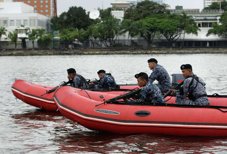 Members of the Philippine Coast guard anti-terrorist unit conduct a maritime patrol at the back of the U.S. Embassy in Manila, Philippines on Thursday Sept. 13, 2012. Security was increased at U.S. embassies and consulates around the world following an attack that killed a U.S. ambassador in Libya. (AP Photo/Aaron Favila) / AP