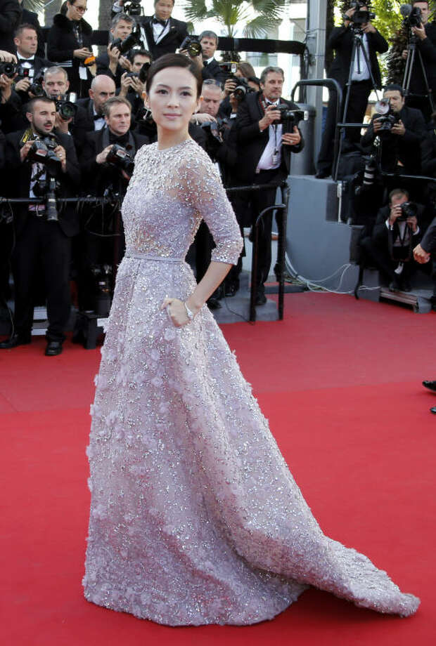 Actress Zhang Ziyi arrives on the red carpet for the screening of Venus in Fur at the 66th international film festival, in Cannes, southern France, Saturday, May 25, 2013. (AP Photo/Francois Mori)