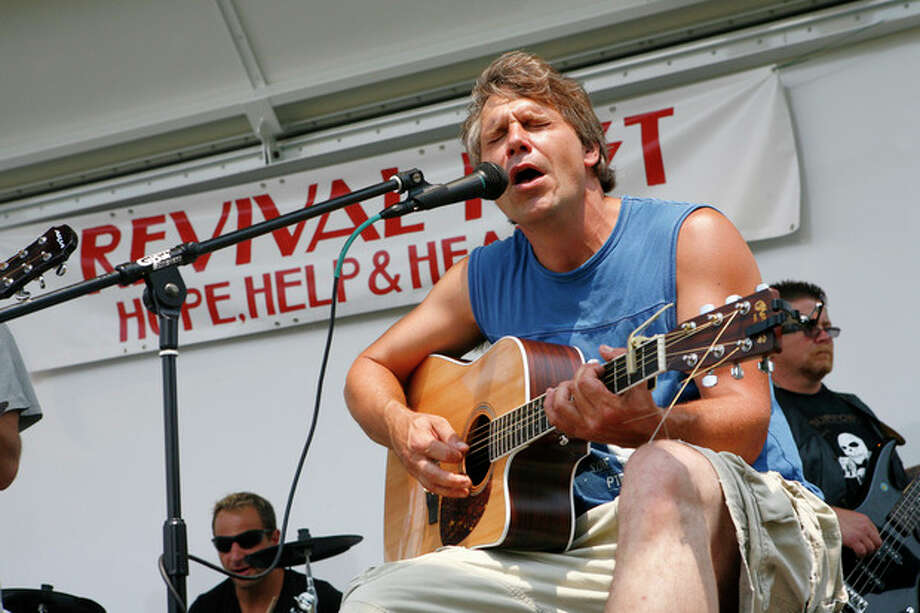 Paul Juchniewich, Guitarist and vocalist for the Calvary Chapel band sings for the public at Revival Fest Saturday afternoon at Calf Pasture Beach.Hour photo / DAVID ESPOSITO