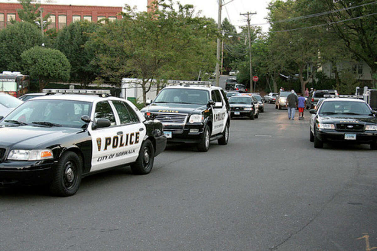 Photo by Chris Bosak Norwalk Police responded in force to a reported shooting at 80 Fair Street on Thursday evening.