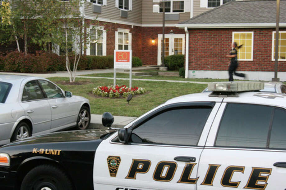 Hour photo / Chris BosakNorwalk Police responded in force to a reported shooting at 80 Fair St. on Thursday evening.