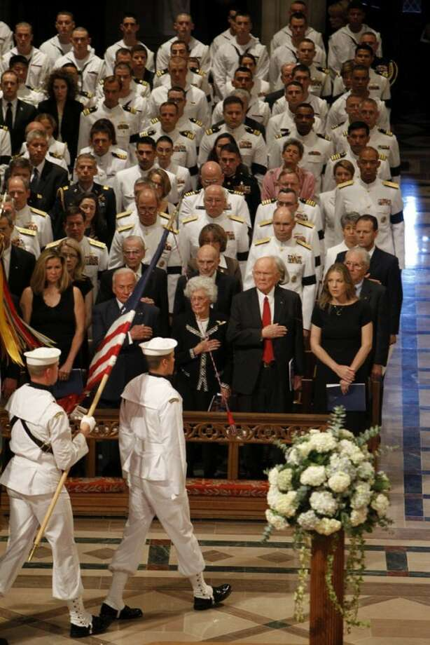 From right to left, singer Diana Krall, astronaut, and former Ohio Sen. John Glenn, his wife Annie, and astronaut Buzz Aldrin, stand during the processional at the Washington National Cathedral in Washington, Thursday, Sept. 13, 2012, during a national memorial service for the first man to walk on the moon, Neil Armstrong. (AP Photo/Ann Heisenfelt)
