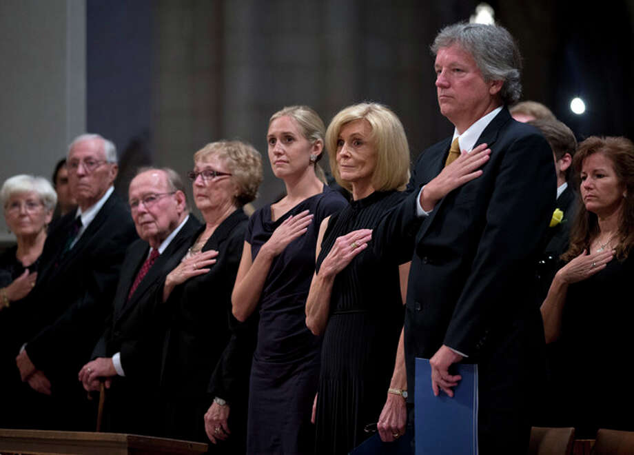 Family members of Apollo 11 astronaut Neil Armstrong take part in memorial service at the National Cathedral in Washington, Thursday, Sept. 13, 2012. From left are, Kathryn Armstrong, Dean Armstrong, Jack Hoffman, June Hoffman, Moly Van Wagenen, Carol Armstrong, and Rick Armstrong, (AP Photo/Evan Vucci, Pool) / AP POOL