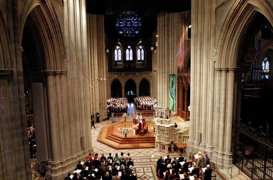 Members of the congregation stand at the Washington National Cathedral in Washington, Thursday, Sept. 13, 2012, during the national memorial service for the first man to walk on the moon, Neil Armstrong. (AP Photo/Ann Heisenfelt) / FR13069 AP