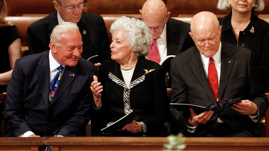 Annie Glenn, wife of astronaut and former Ohio Sen. John Glenn, right, chats with astronaut Buzz Aldrin, at the Washington National Cathedral in Washington, Thursday, Sept. 13, 2012, before a national memorial service for the first man to walk on the moon, Neil Armstrong. (AP Photo/Ann Heisenfelt) / FR13069 AP