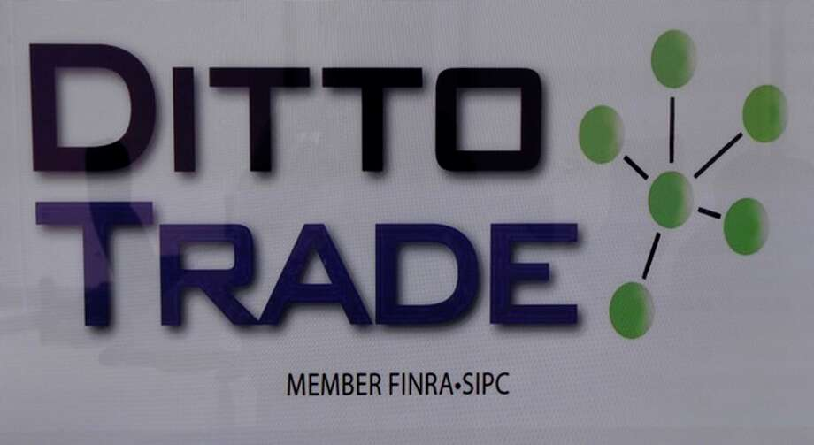 In this Sept. 12, 2012, photo, the Ditto Trade logo is seen in the company's his offices in Los Angeles. Ditto Trade is a new online brokerage firm where one can attach their stock portfolio to that of person they trust, so that when they make a trade, so will you. (AP Photo/Reed Saxon) / AP