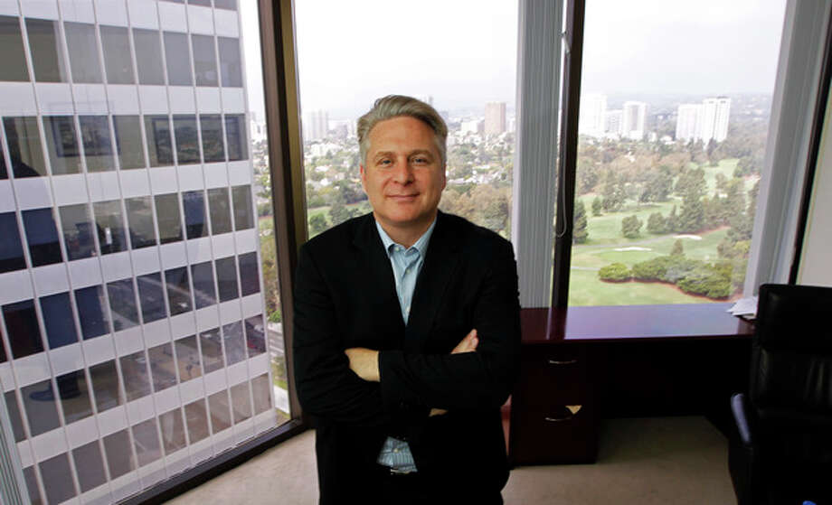 In this Sept. 12, 2012, photo, Joe Fox, CEO of Ditto Trade, poses in his offices in Los Angeles. Ditto Trade is a new online brokerage firm where one can attach their stock portfolio to that of person they trust, so that when they make a trade, so will you. (AP Photo/Reed Saxon) / AP
