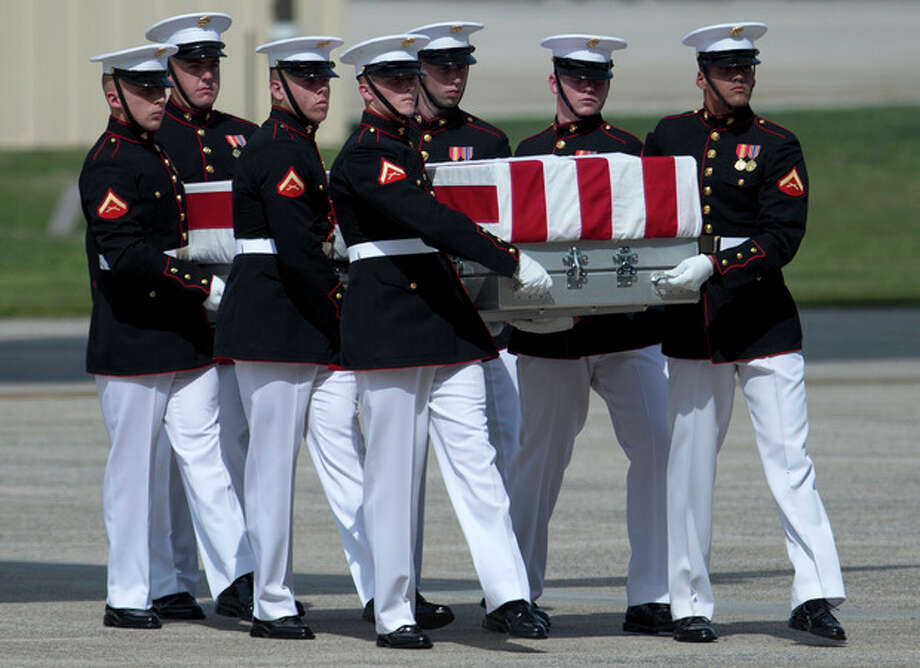 A carry teams moves a flag-draped transfer case of the remains of one of the Americans killed this week in Benghazi, Libya, from a transport plane during the Transfer of Remains Ceremony, Friday, Sept. 14, 2012, at Andrews Air Force Base, Md., marking the return to the United States of the remains of the four Americans killed this week in Benghazi, Libya. (AP Photo/Carolyn Kaster) / AP