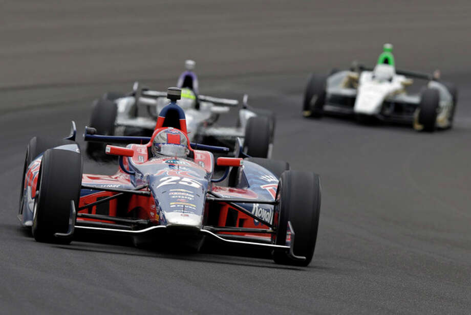 Marco Andretti drives through the first turn during the Indianapolis 500 auto race at Indianapolis Motor Speedway in Indianapolis, Sunday, May 26, 2013. (AP Photo/Tom Strattman) / FR29600 AP