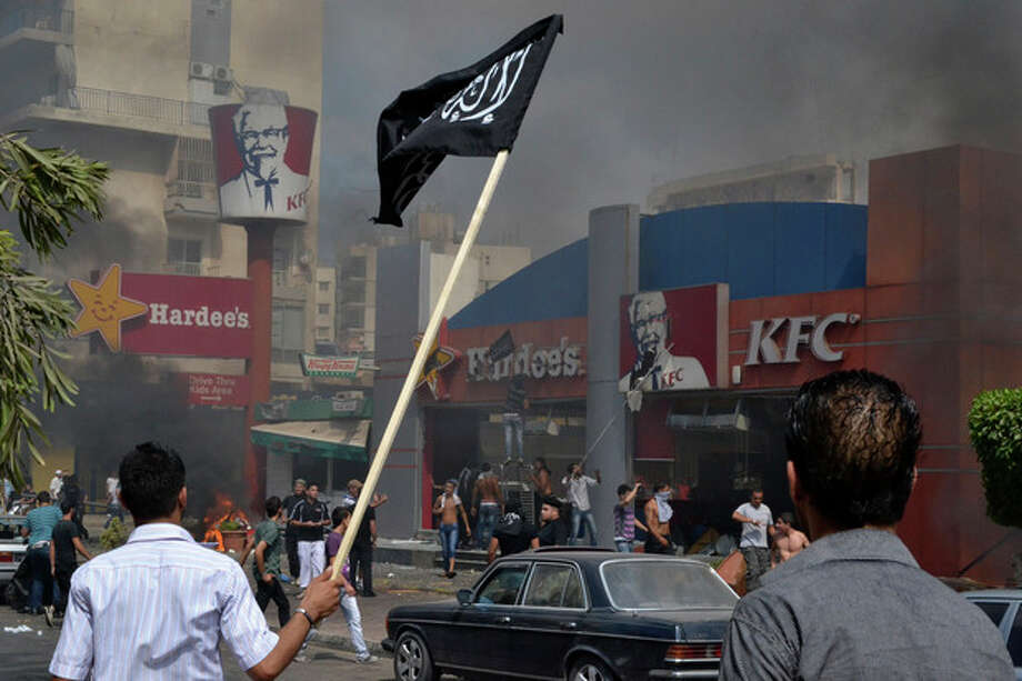 Lebanese protesters attack American fast food restaurants after Friday prayers, pouring petrol on the restaurants and setting them on fire in the northeastern city of Tripoli, Lebanon, Friday Sept. 14, 2012. According to security officials no one was hurt in the attack which is part of widespread anger across the Muslim world about a film ridiculing Islam's Prophet Muhammad. (AP Photo) / AP