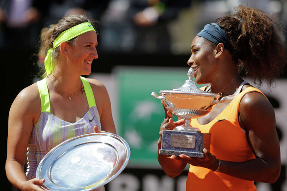Serena Williams, of the United States, right, flanked by Belarus' Victoria Azarenka poses with the trophy after winning her final match at the Italian Open tennis tournament in Rome, Sunday, May 19, 2013. Serena Williams won her fourth consecutive title of the year in dominating fashion Sunday, beating third-seeded Victoria Azarenka 6-1, 6-3 in the Italian Open final. (AP Photo/Andrew Medichini) / AP