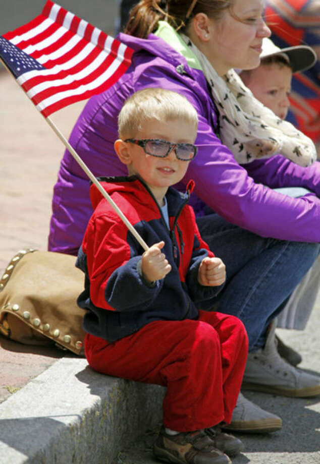 Quinn Dickinson, 3, watches Stamford's Memorial Day Parade Sunday afternoon.Hour Photo / Danielle Robinson