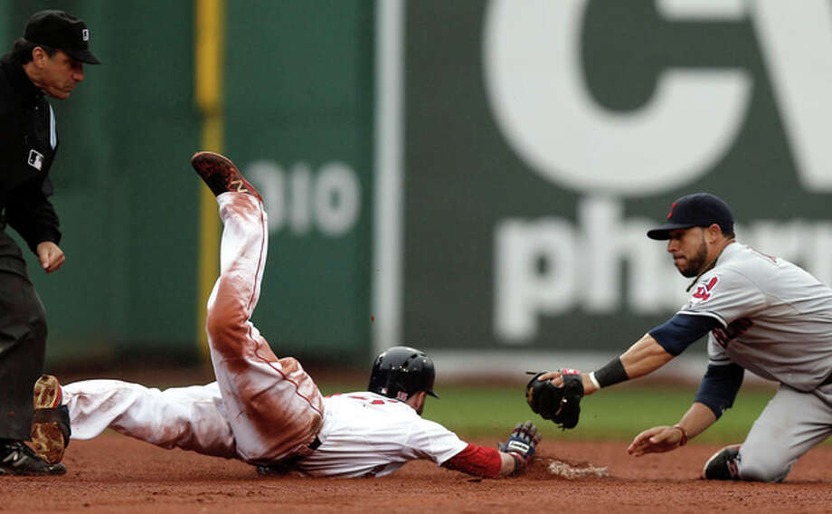 Boston Red Sox's Dustin Pedroia slides safely into second on his go ahead RBI double as Cleveland Indians' Mike Aviles tries for the tag during the eighth inning of their 7-4 win in a baseball game at Fenway Park in Boston Saturday, May 25, 2013. (AP Photo/Winslow Townson) / FR170221 AP