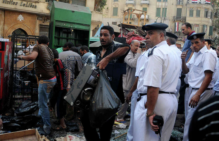 Egyptian street vendors salvage what they can of their belongings after police cleared Tahrir Square in Cairo, Egypt, Saturday, Sept. 15, 2012 after days of protests near the U.S. embassy over a film insulting Prophet Muhammad. (AP Photo/Mohammed Asad) / AP