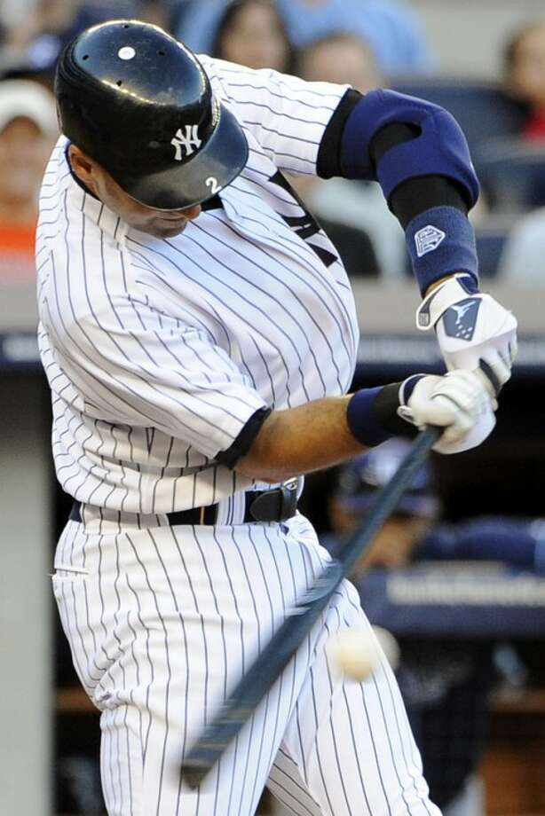 New York Yankees' Derek Jeter connects for an RBI single off of Tampa Bay Rays starting pitcher James Shields in the fifth inning of a baseball game, Saturday, Sept. 15, 2012, at Yankee Stadium in New York. (AP Photo/Kathy Kmonicek)