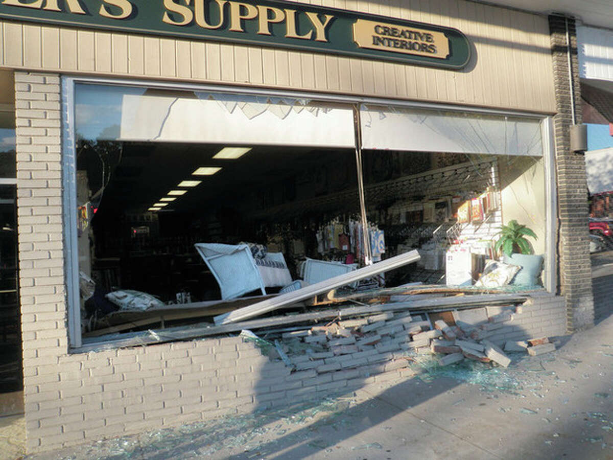 At 6 p.m. Saturday the Westport Fire Department responded with the Westport Police Department to a reported car into a building in the Compo Shopping Center. Upon arrival units found a Lexus SUV had jumped the curb and drove approximately two feet into the Painters Supply Store breaking both display windows. The driver was unhurt and the vehicle suffered only minor damage. The store was closed at the time of the incident. Firefighters remained on scene for an hour while the Building Official, property manager and business owner assessed the damage. The store suffered minor structural damage so firefighters worked to remove the shattered glass and mark off the area on the sidewalk in front of the store until it is boarded up by a contractor. Photos courtesy of Asst. Chief William Dingee, Shift Commander