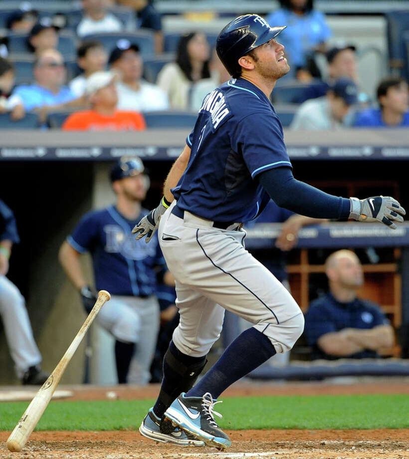 Tampa Bay Rays' Evan Longoria watches his solo home run off of New York Yankees starting pitcher Ivan Nova in the sixth inning of a baseball game, Saturday, Sept. 15, 2012, at Yankee Stadium in New York. (AP Photo/Kathy Kmonicek) / FR170189 AP
