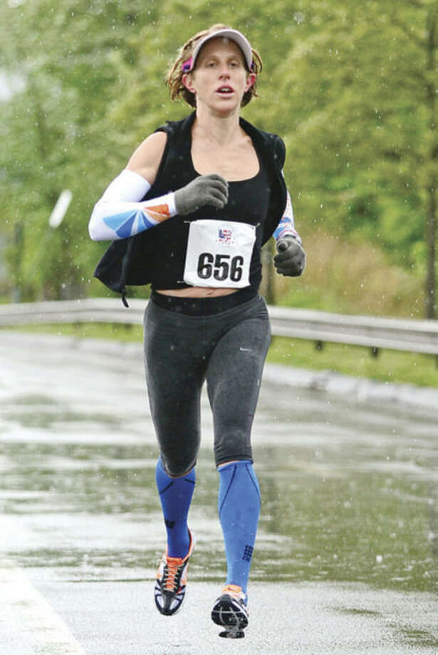 Amy Bevilacquais the first woman to cross the finishline at the Weston Memorial Day 5K race at Weston High School Saturday morning.Hour photo / Erik Trautmann