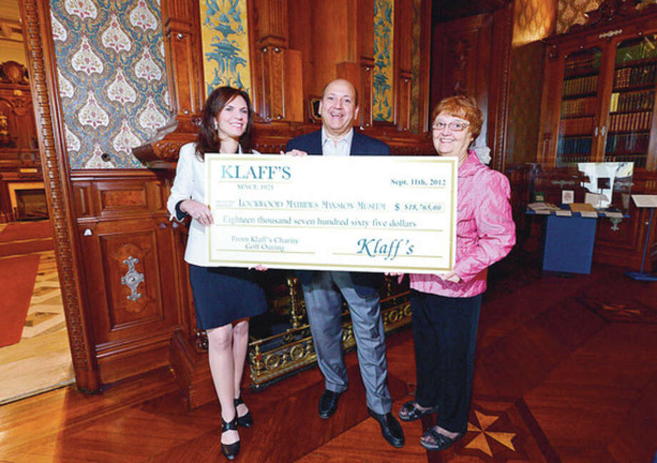 Hour photo / Erik TrautmannLockwood Mathews Mansion Museum Executive Director Susan Gilgore, Klaff's CEO Joe Passero and Patsy Brescia, chair of the LMMM Board off Directors, hold a check from Klaff's benefit golf outing for $18,765 that will go into the Museum's operating fund. / (C)2012, The Hour Newspapers, all rights reserved