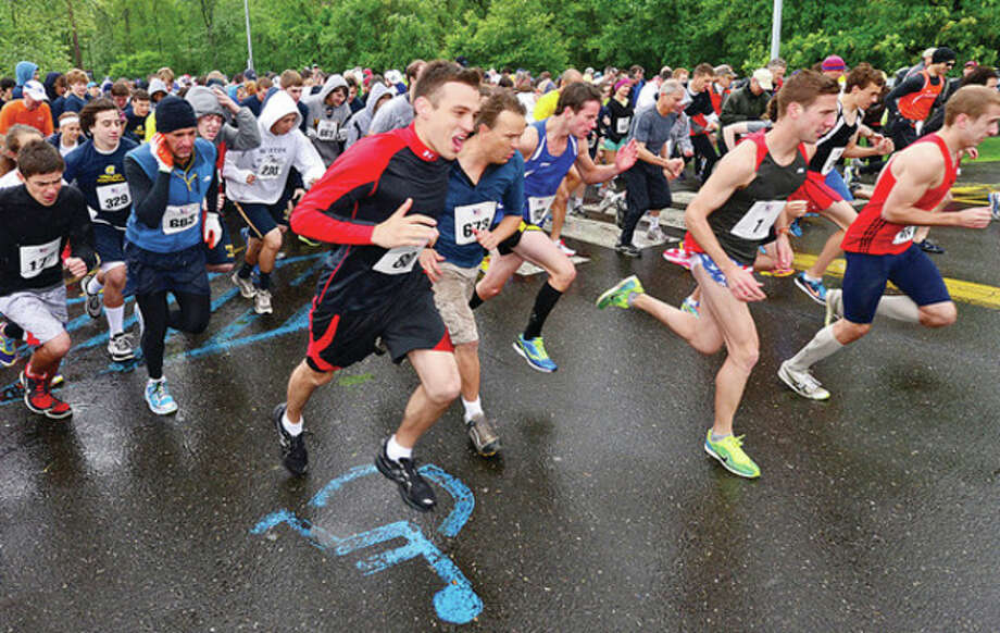 Hour photo/Erik TrautmannHundreds of runners turn out for Weston Memorial Day 5K race at Weston High School Saturday morning. / (C)2013, The Hour Newspapers, all rights reserved