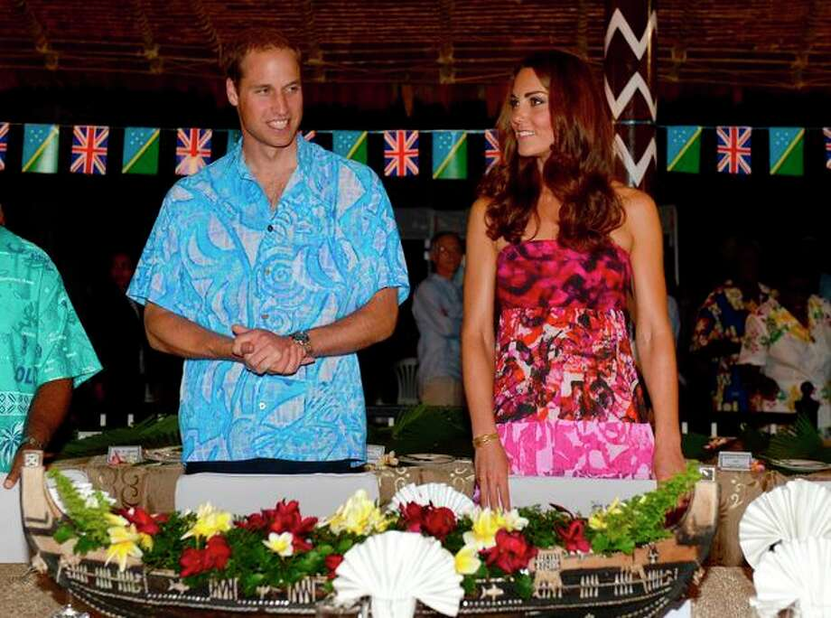 Britain's Prince William, left, and his wife Kate prepare to sit for a meal at Government House in Honiara, Solomon Islands, Sunday, Sept. 16, 2012. The royal couple is on a nine-day tour of the Far East and South Pacific in celebration of Queen Elizabeth II's Diamond Jubilee. (AP Photo/William West, Pool) / AFP POOL